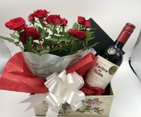 Mini rose plant, Wine, Chocolates